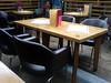 Table on the mezzanine level of Indigo Yard, Edinburgh