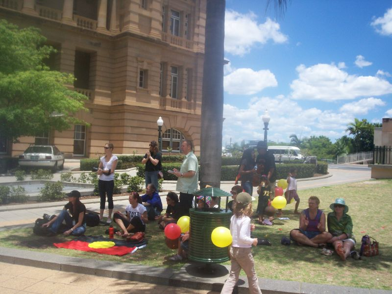 Relaxing before the rally 2 - Justice for Mulrunji Rally at Queens Park and March through Brisbane City, Australia, November 18 2006