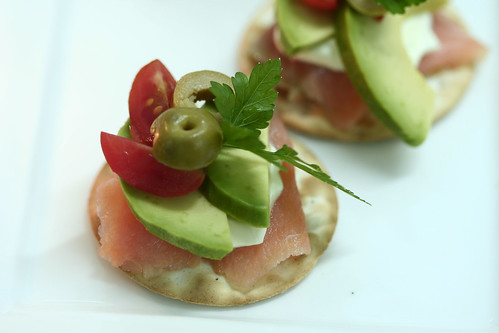 Smoked salmon, avocado, organic cherry tomato and creme fraiche on Table Water crackers