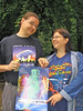 Ben and Irma holding a poster of Finncon 2006