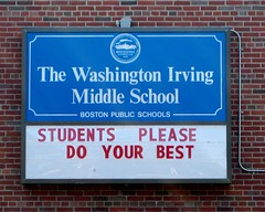 Sign on a school in Roslindale that reads: Students please do your best