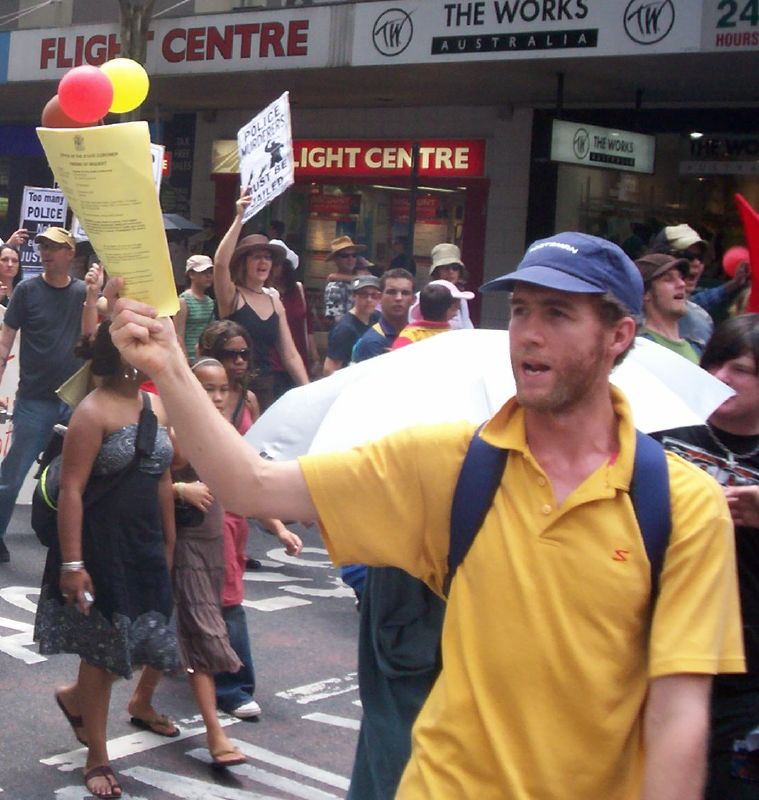 Body of the march passes through the Adelaide St and Edward St intersection, turning right into Edward St-1 - Justice for Mulrunji Rally at Queens Park and March through Brisbane City, Australia, November 18 2006