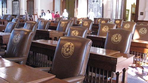 Leather chairs with state emblem