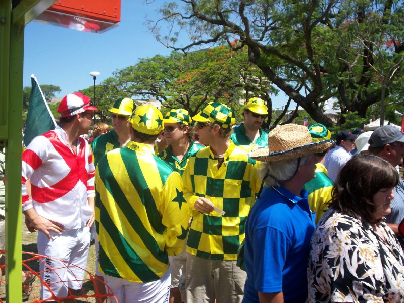 Ride that horse to victory! Australian and English fans in jockeys' silks - The Ashes 2006-7 - First Test - Atmosphere in town, outside the Gabba, and watching the game on a big screen at the 'beach' in Southbank.