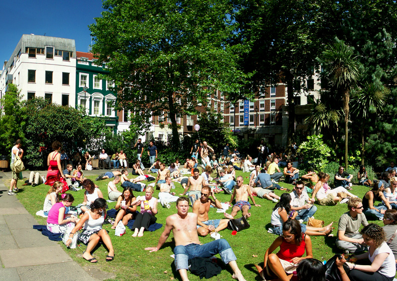 Soho Square in London filled with people