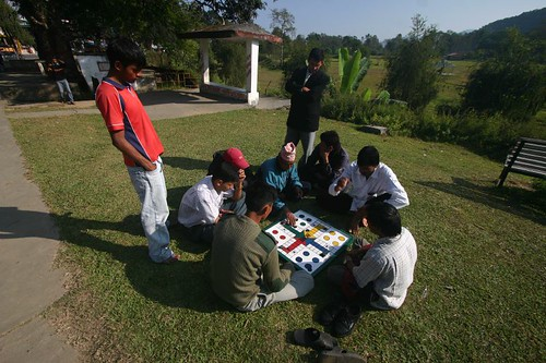 Playing ludo in the grass...Pokhara, Nepal