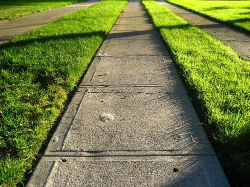 Sunlight shadows on the sidewalk, Friday afternoon