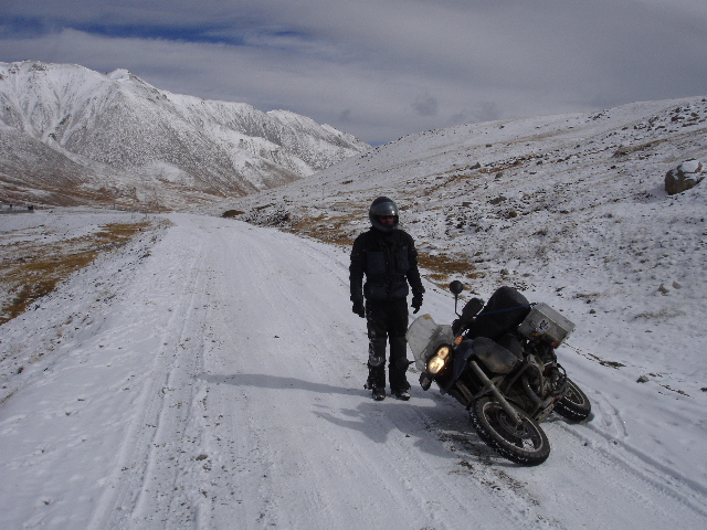 Tom takes a fall in the snow on the road just next to the Chinese/Pakistani border at the Kunjerab Pass on the Karakoram Highway