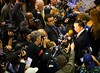Rep. Dennis Kucinich Talks With Reporters in the Spin Room Following the Deabtes