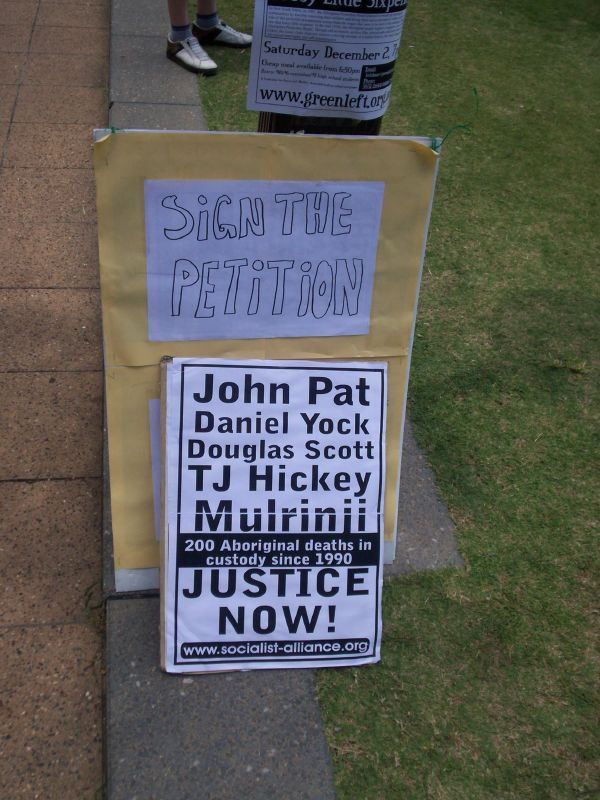 Socialist Alliance - Resistance placard and petition - Justice for Mulrunji Rally at Queens Park and March through Brisbane City, Australia, November 18 2006
