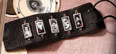 slides charms on leather bracelet