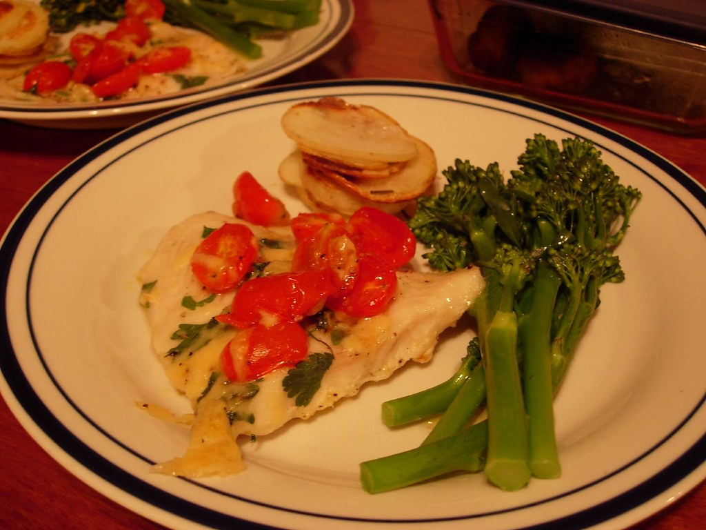 Main - Oven baked Basa fish w/ grape tomatoes and parmesan