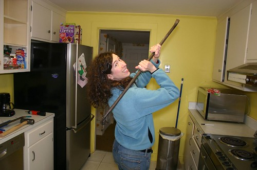 Jennifer demonstrates the crowbar as back scratcher