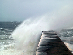 Sea crashing over Creevy Pier