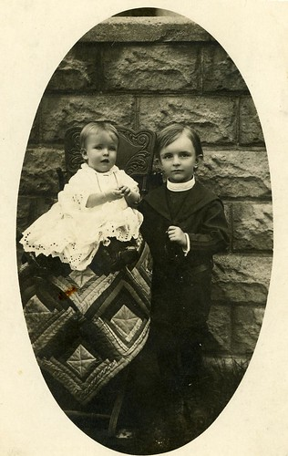 Uncle Pete and his sister, with a quilt