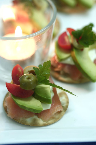 Smoked salmon, avocado, green olives, organic cherry tomato and creme fraiche on Table Water crackers