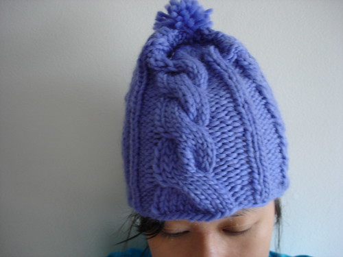 asymmetrical hat on