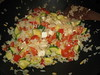 Gebakken rijst met groente, feta en pijnboompitten