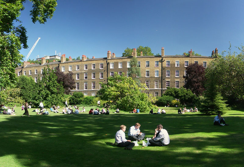 Lawyers eating lunch in Grays Inn Fields in London
