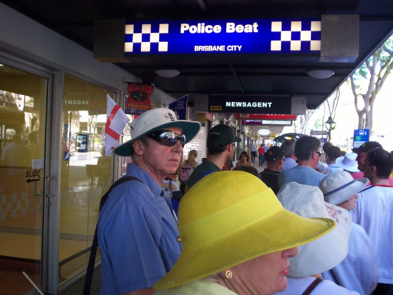 Fans waiting for the bus to the Gabba in Adelaide St, Brisbane City - The Ashes 2006-7 - First Test - Atmosphere in town, outside the Gabba, and watching the game on a big screen at the 'beach' in Southbank.