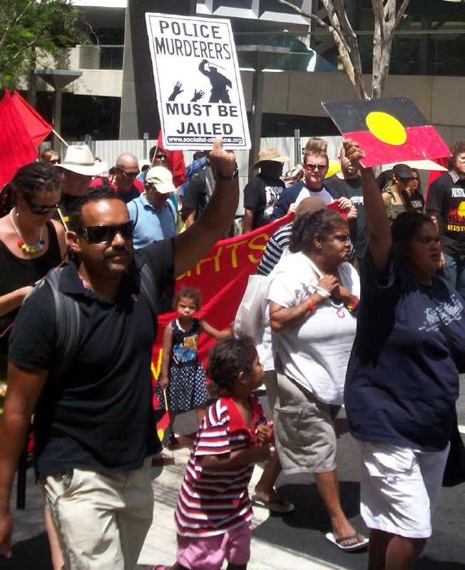Marcher just outside Archives Bookshop, Charlotte St - Justice for Mulrunji Rally at Queens Park and March through Brisbane City, Australia, November 18 2006