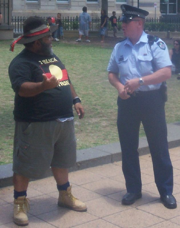 Sam Watson, rally organiser, discusses details with a police senior-sergeant - Justice for Mulrunji Rally at Queens Park and March through Brisbane City, Australia, November 18 2006