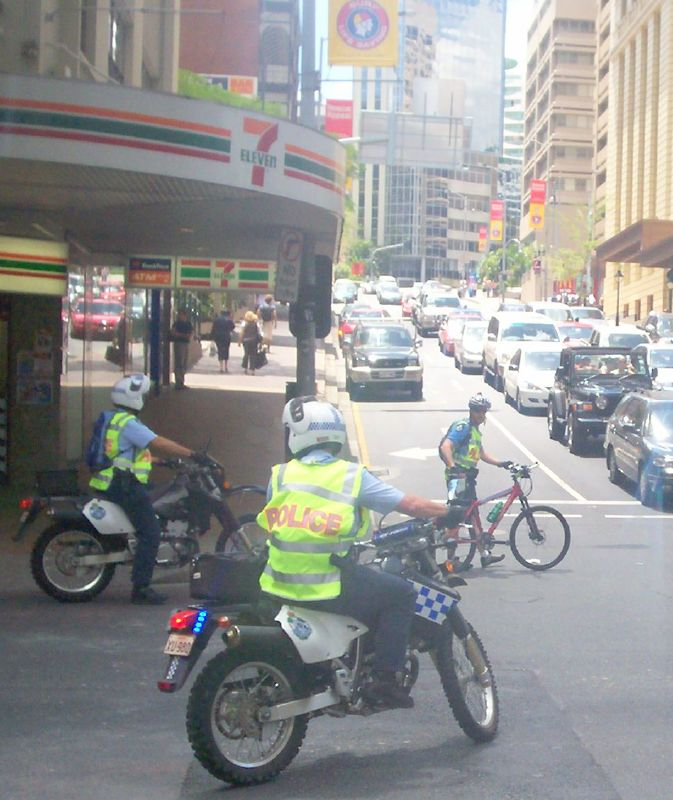 Two Wheeled Police deploy to stop traffic on Edward St entering the Adelaide St intersection - Justice for Mulrunji Rally at Queens Park and March through Brisbane City, Australia, November 18 2006