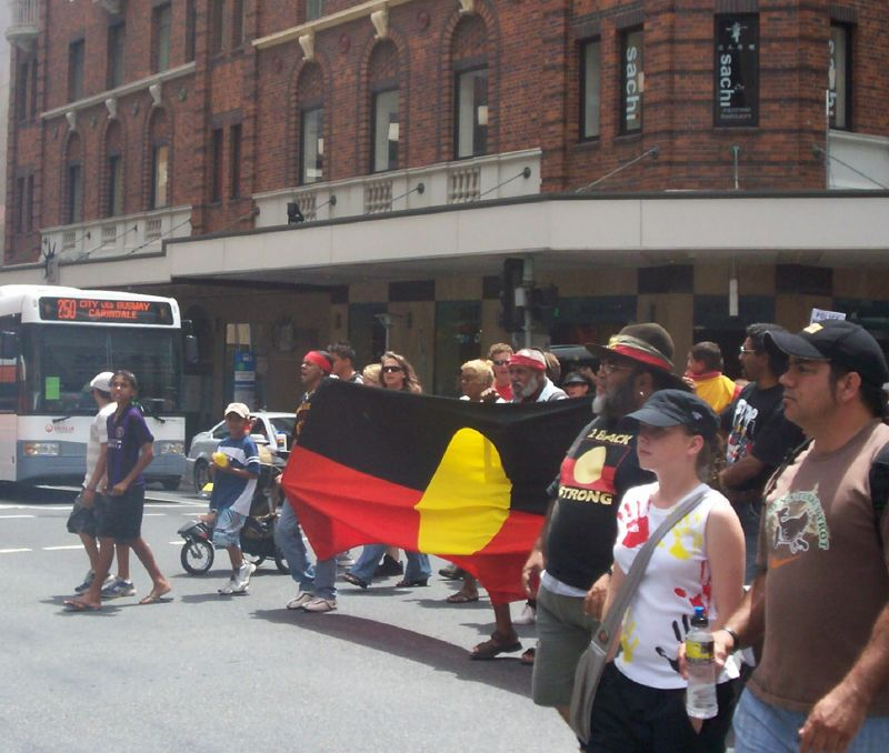 Van of the march crosses Elizabeth St, heading towards the Botanic Gardens on Edward St - Justice for Mulrunji Rally at Queens Park and March through Brisbane City, Australia, November 18 2006