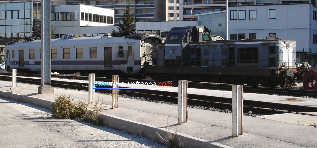 A BB 66000 Diesel locomotive with a catenary maintenance car at the Marseille Saint-Charles station