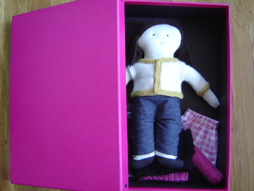 doll in her box
