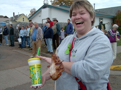 Shannon with turkey on a stick.