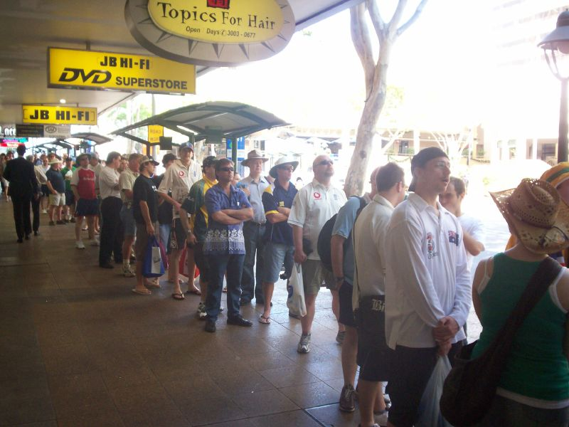 Line up in Adelaide St, Brisbane City, for buses to the Gabba - The Ashes 2006-7 - First Test - Atmosphere in town, outside the Gabba, and watching the game on a big screen at the 'beach' in Southbank.