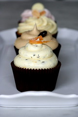 orange rosemary cupcake with pine nuts photo by chockylit