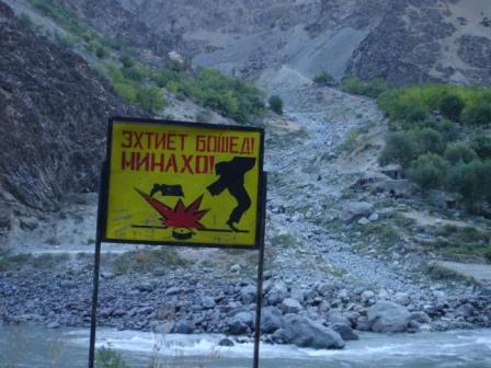 A landmine sign across the Panj River from Afghanistan on the road from Khorog, Tajikistan to Kala-i-Khumb, Tajikistan