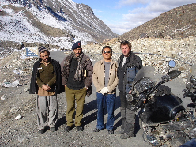 Tom with some of the Pakistani police and a Chinese road engineer at the police post 15km from the Kunjerab Pass on the Karakoram Highway