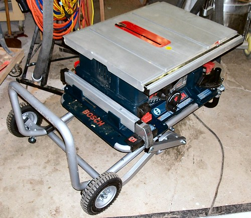 Review review of the bosch 4000 portable table saw and folding the photos show the table saw in its working position with the legs unfolded then with the legs folded and then finally with the system on the wheels greentooth Choice Image