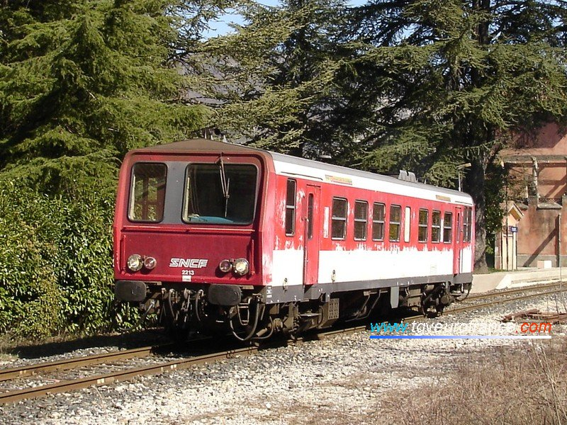 A detailed view of an X2200 railcar with its original red and white livery