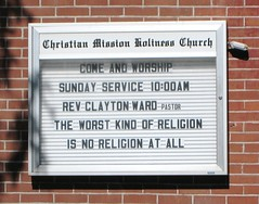 Sign on a church reading: The worst kind of religion is no religion at all.