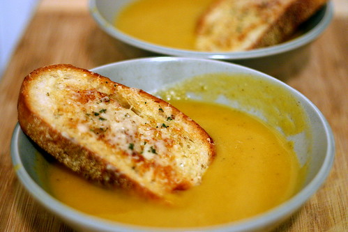 two squash soup, one gruyere crouton