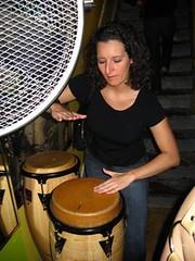 Jess plays bongos