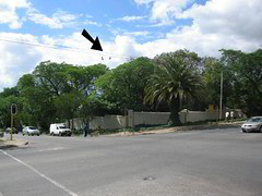 The two pairs of shoes in the intersection, travelling north