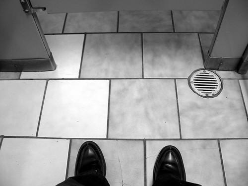 my feet in a bathroom wearing Aidan's wedding shoes