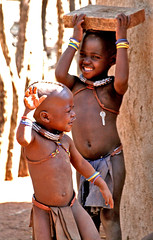 Himba children playing and dancing - Namibia photo by Christophe Paquignon
