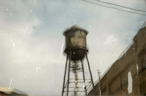 Water Tower Reflected in Window