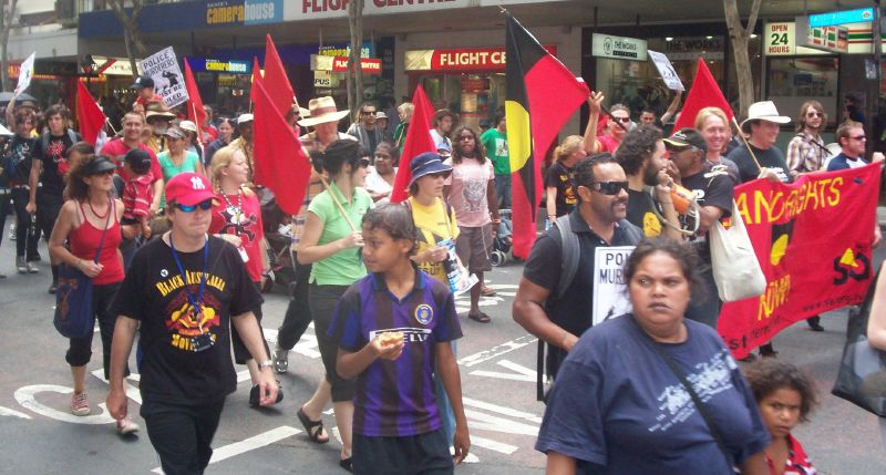 Body of the march passes through the Adelaide St and Edward St intersection, turning right into Edward St-2 - Justice for Mulrunji Rally at Queens Park and March through Brisbane City, Australia, November 18 2006