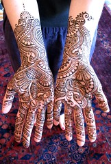 bride's henna'd hands photo by HennaLounge