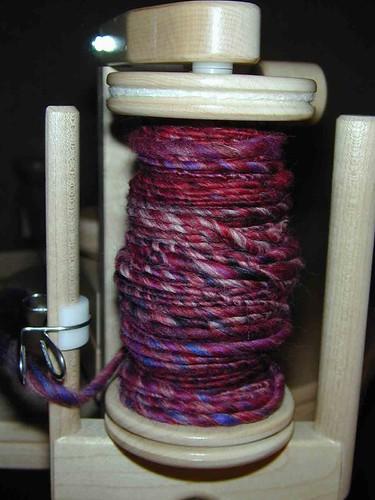 Closeup Merino Top Cranberry - on the wheel