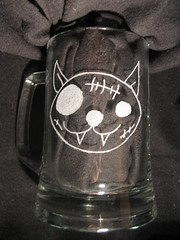 Pirate Cat etched on glass.