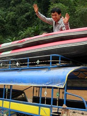 Driver unloading kayaks from the tuk tuk - Nam Ha River