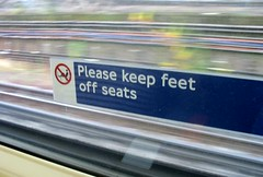 Please keep feet off seats Tube sign